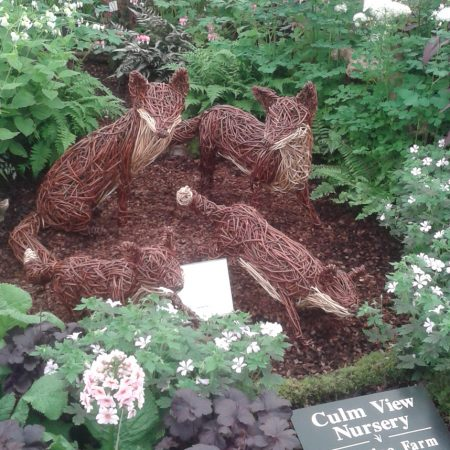 Willow sculpture of Chelsea flower show Foxes
