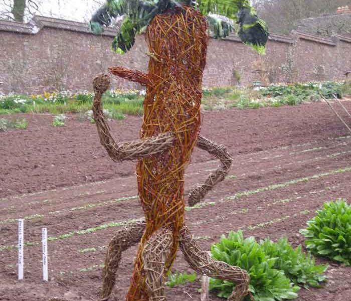 Willow sculpture of giant walking carrot man