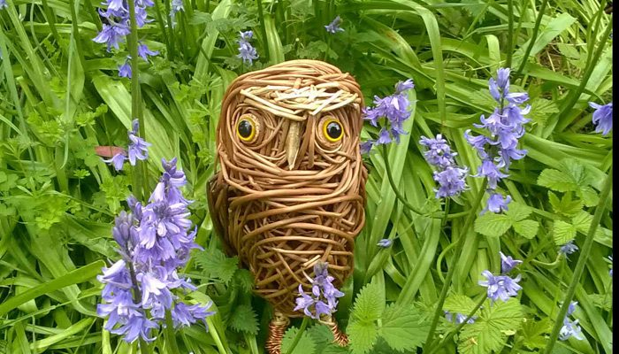 The little owl is made from various types of willow and has glass eyes and aluminium wire feet.