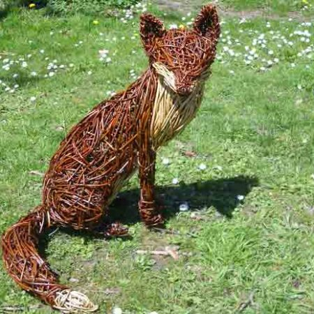 Willow sculpture of a sitting fox