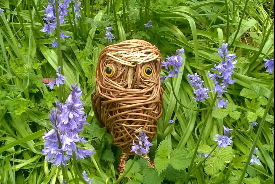 Willow sculpture of a little owl