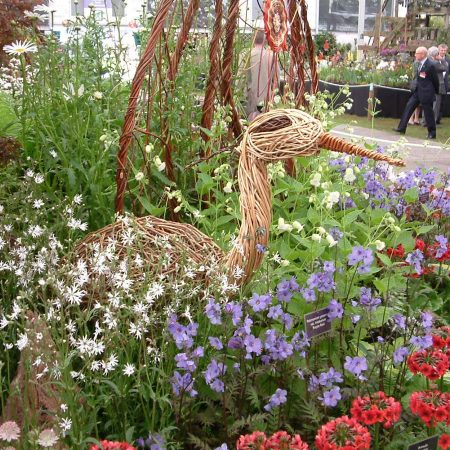 Willow sculpture of a heron at chelsea flower show