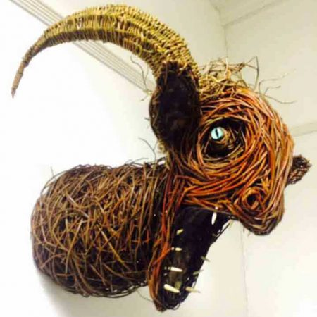 Willow sculpture of a faun head