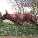 Willow sculpture of a wild dog