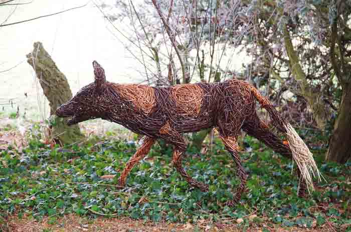 Willow sculpture of a wild dog