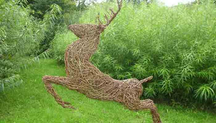 Here is a stag that is stylised and leaping.