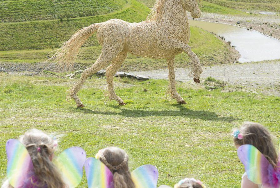 Willow sculpture of white unicorn