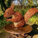 Willow sculpture of a giant red squirrel