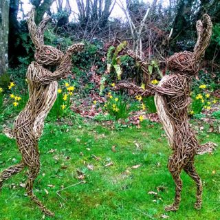 Willow sculpture of boxing hares