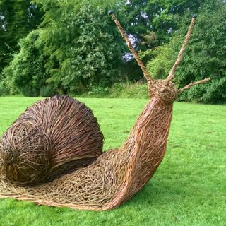 Willow sculpture of a giant snail