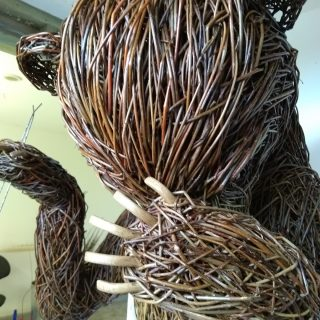 Willow sculpture of a Brown Bear