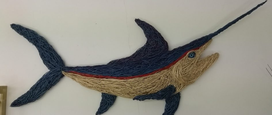 This 7 foot long Marlin goes on the wall like a hunting trophy but without any of the cruelty! Its made of various dyed willows and a big glass eye.