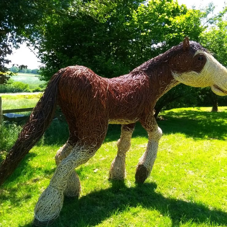 Willow sculpture of a 7 foot high Clydesdale horse