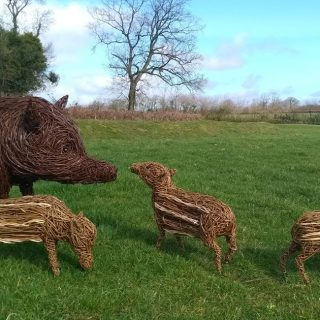 Willow sculpture of wild boar and piglets