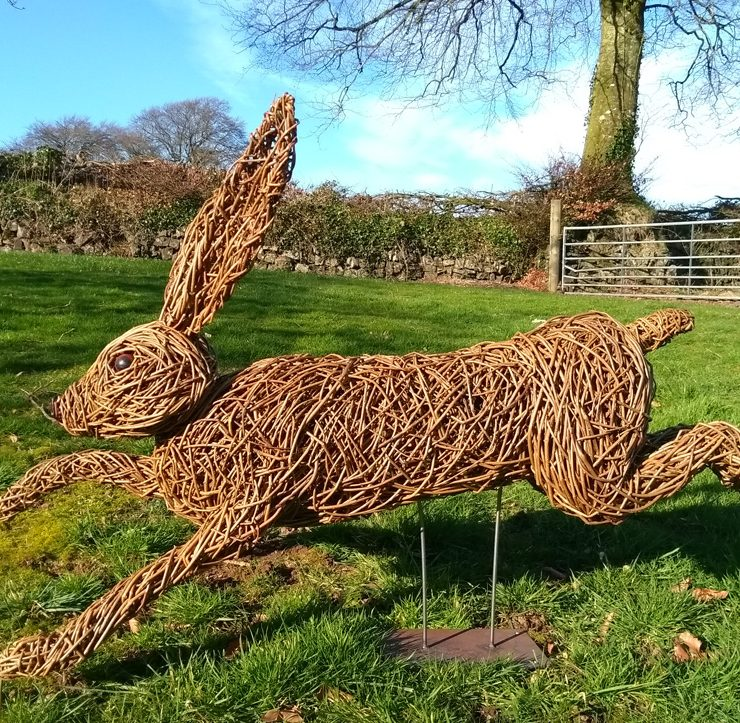 Willow sculpture of a running hare