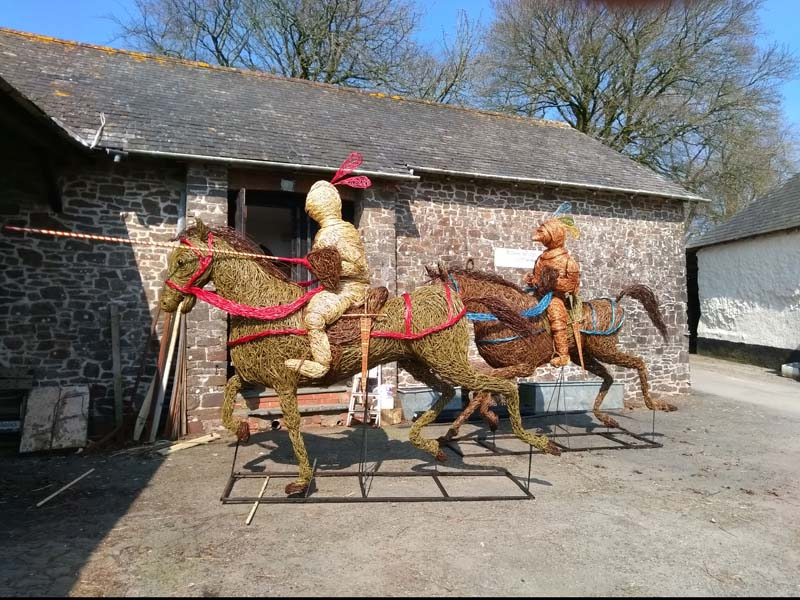 Both jousting knights on horseback willow sculptures.