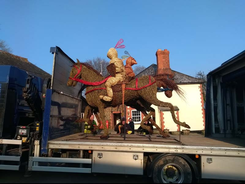 Both jousting knights on horseback willow sculptures on the lorry.