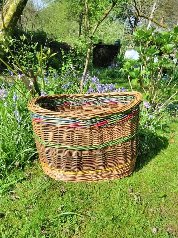 Willow washing basket with coloured banding