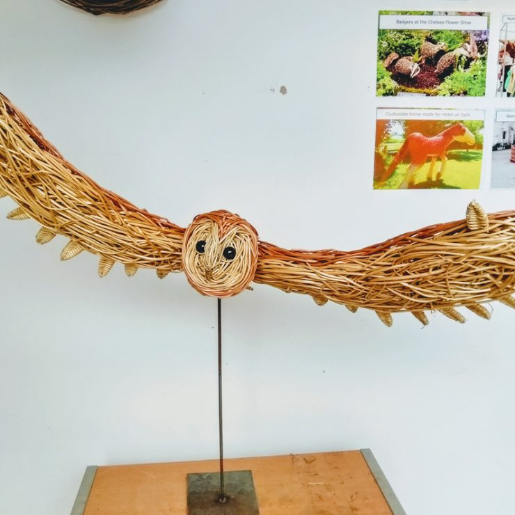 flying barn owl willow sculpture
