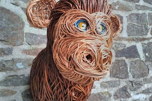 This monkey head is about 2 foot high, its made of brown, buff and dyed willow with glass eyes.