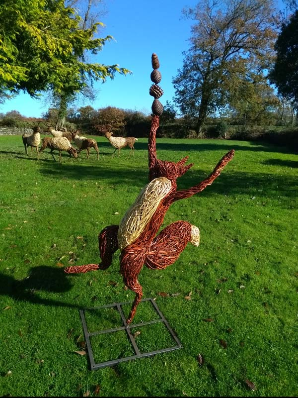 5 foot high dancing red squirrel willow sculpture